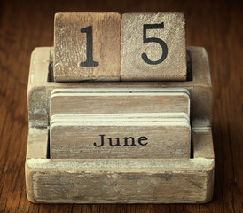 A very old wooden vintage calendar showing the date 15th June on
