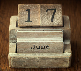A very old wooden vintage calendar showing the date 17th June on