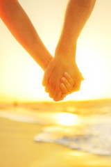 Couple in love holding hands - happy relationship