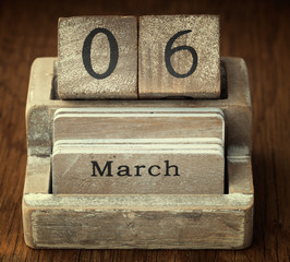A very old wooden vintage calendar showing the date 6th March on