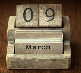 A very old wooden vintage calendar showing the date 9th March on