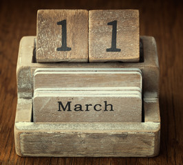 A very old wooden vintage calendar showing the date 11th March o
