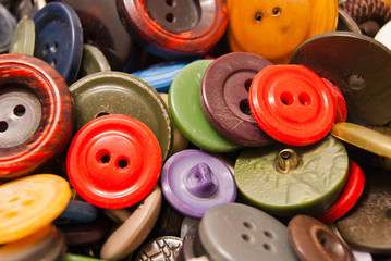 texture of different colored clothing buttons
