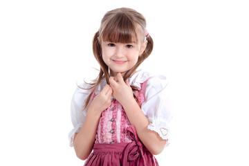 Kleines Mädchen im Dirndl lächelt süß