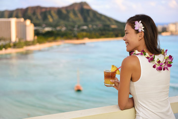Hawaiian woman drinking Mai Tai in Waikiki, Hawaii