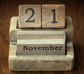 A very old wooden vintage calendar showing the date of 21st  Nov