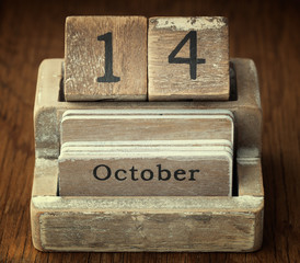 A very old wooden vintage calendar showing the date of 14th Octo