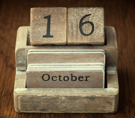 A very old wooden vintage calendar showing the date of 16th Octo