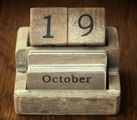 A very old wooden vintage calendar showing the date of 19th Octo