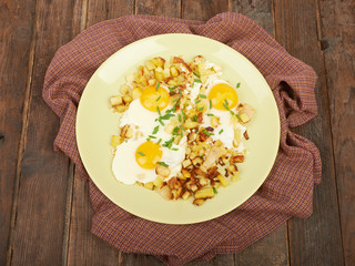 Fried potatoes with eggs on the table