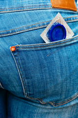 Condom in a jeans pocket.
