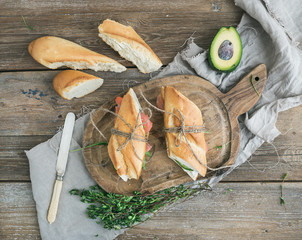 Salmon, avocado and thyme sandwiches in baguette tied