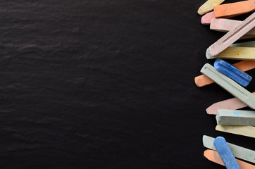 Colorful chalks on a table