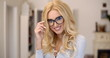 Serious attractive blond woman wearing glasses