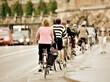 Leinwanddruck Bild - Bicycles in evening traffic.