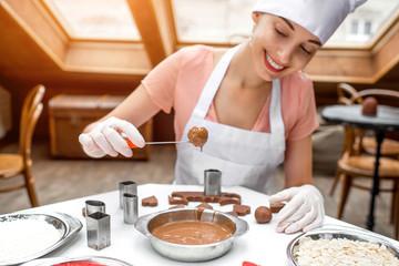 Woman making handmade candy