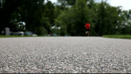 Runner starting on road