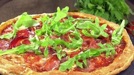 Fresh made Ham Pizza with Rocket (seamless loopable)