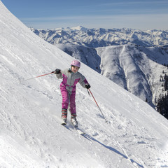 Young downhill skier, winter activity