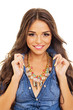 Gorgeous young woman in denim shirt and modern necklace