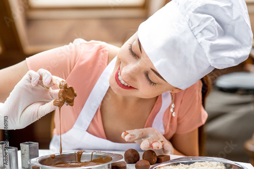 Woman making handmade candy - 78861913