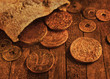 Ancient coins on wooden background with texture effect - 78862371