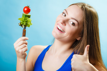 Dieting weight loss concept. Girl with vegetables