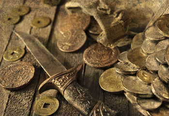 Still life with ancient coins, dagger and grunge texture effect