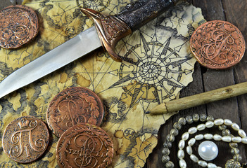 Pirate still life with dagger, coins and map