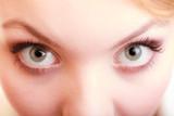 Part of face female eyes. Blonde girl wide eyed.