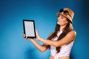 Girl showing blank copy space screen of tablet touchpad