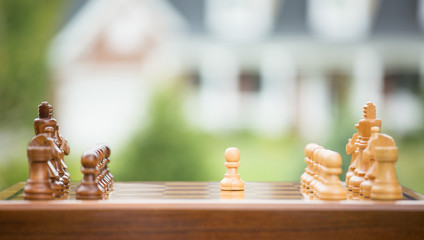 First move over wood chessboard. Real estate sale loan market