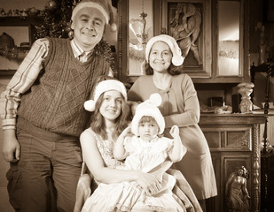 Imitation of antique photo of happy family in Santa hat