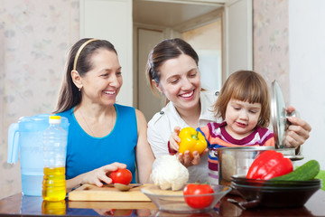 Happy family together cooking lunch