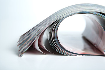 stack of magazines on the table