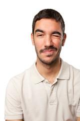 Young man winking an eye