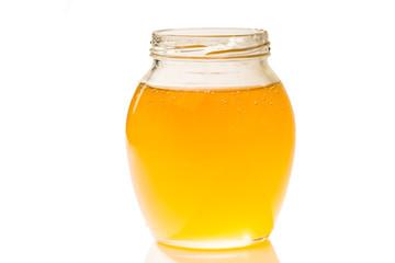 an image of jar of honey isolated on white background