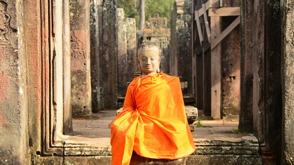 Statue of Robed Buddha in Ancient Temple  - Angkor Wat Temple Cambodia
