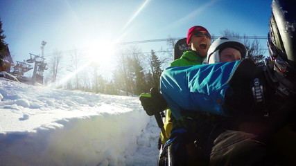 Dad and son on the Bobsleigh attraction during winter holiday.
