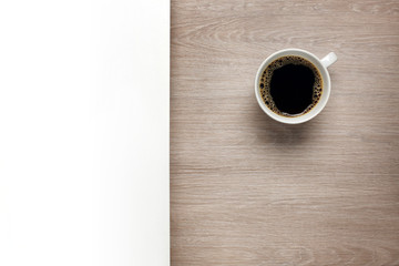 Cup of coffee on desk with white space