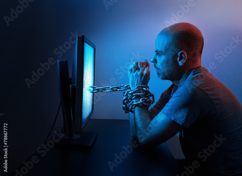 Man chained to computer - 78867772
