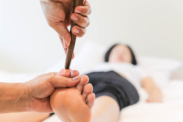 Woman receiving a Reflexology foot massage