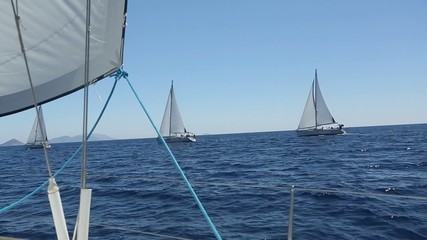 Cruising on a sailing boat. Boat in sailing regatta.