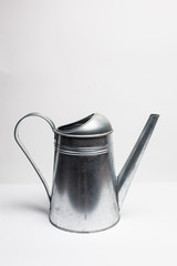 metal pitcher over white
