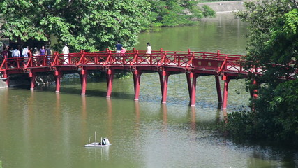 People Walking over The Hu Bridge on Hoan Kiem Lake in Hanoi Vietnam
