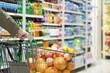 man pushing a shopping cart in the supermarket.