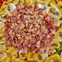 gourmet salad with spicy bacon and mushrooms