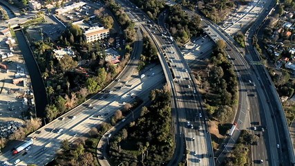 Speed Up Aerial View of Los Angeles Freeway / Highway / Suburbs - Clip 7