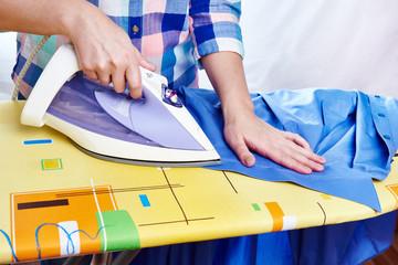 Woman ironed men's shirt