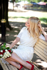 Bride sitting on a bench